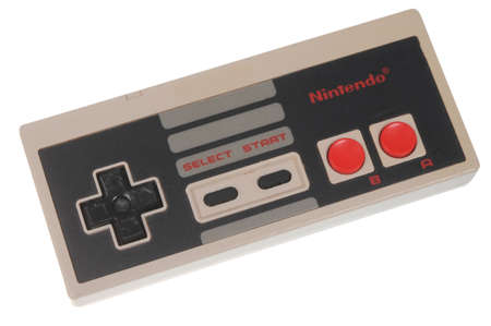 nintendo: Adelaide, Australia - February 23, 2016: A studio shot of a Nintendo Entertainment System (NES) Controller. A popular 8-bit entertainment system sold worldwide during the 1980s. Editorial