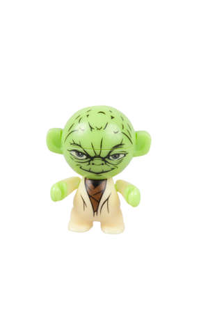 kinder: Adelaide, Australia - July 29, 2015: An isolated Yoda Kinder Egg Toy photo. Kinder Surprise eggs are a popular treat for children and the toys contained inside are highly sought after collectables. Editorial