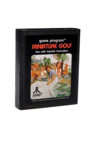gamers: Adelaide, Australia - February 23 2016: A Studio shot of an Atari 2600 Miniature Golf Game Cartridge. A popular video game from the 1980s is popular with collectors and retro gamers worldwide.
