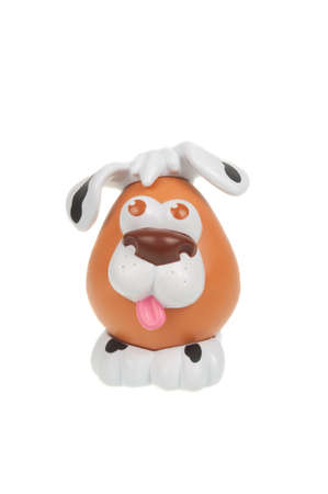 toy story: Adelaide, Australia - January 15, 2016: A Mr Potato Head Dog toy isolated on a white background. Mr Potato Head is a popular toy which has been in production since 1952. The toy has also appeared in Television series, the Toy Story Movies and video games.