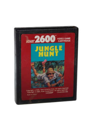 australia jungle: Adelaide, Australia - February 23 2016: A Studio shot of an Atari 2600 Jungle Hunt Game Cartridge. A popular video game from the 1980s is popular with collectors and retro gamers worldwide.