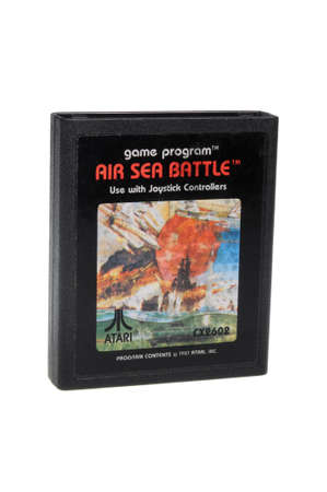gamers: Adelaide, Australia - February 23 2016: A Studio shot of an Atari 2600 Air Sea Battle Game Cartridge. A popular video game from the 1980s is popular with collectors and retro gamers worldwide.
