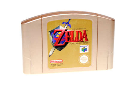 Adelaide, Australia - February 23, 2016: A studio shot of a Gold The Legend of Zelda Nintendo 64 Cartridge,isolated on a white background. A popular game console sold by nintendo worldwide between 1996 and 2003. Nintendo 64 games are now highly sought aft Редакционное