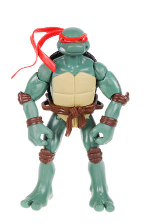 action figure: Adelaide, Australia - February 14, 2016: An isolated image of a Raphael TMNT Action Figure from the Teenage Mutant Ninja Turtles. Teenage Mutant Ninja Turtles is a very popular animated and movie series with merchandise being highly sought after collectab