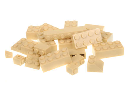bricks background: Adelaide, Australia - May 09, 2016: A studio shot of Beige lego pieces, isolated on a white background. Lego is very popular with children and collectors worldwide.