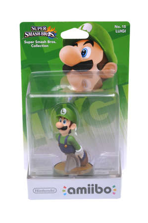 nintendo: Adelaide, Australia - February 23, 2016: A studio shot of a Luigi Nintendo Amiibo Figurine.. This figurine is part of series released by Nintendo where placing the figure on the interface allows players to control that character in the game.