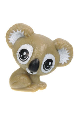 kinder: Adelaide, Australia - July 05, 2016: An isolated Koala Kinder Egg Toy photo. Kinder Surprise eggs are a popular treat for children and the toys contained inside are highly sought after collectables. Editorial