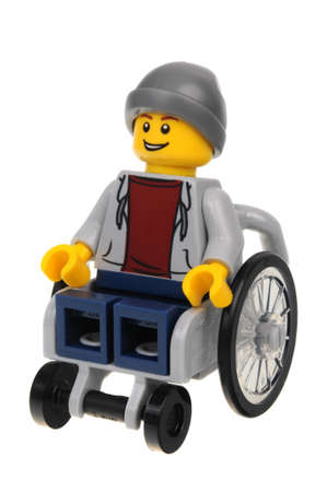 Adelaide, Australia - September 05 2016:A studio shot of a Wheelchair Guy Lego City minifigure from the popular Lego Series. Lego is extremely popular worldwide with children and collectors.