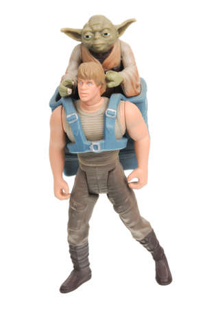 Adelaide, Australia - December 30, 2016: A studio shot of a Luke Skywalker and Yoda Jedi in Training Action Figure on a white background from the Star Wars universe. Star Wars is a very popular movie franchise worldwide and merchandise from Star Wars movi