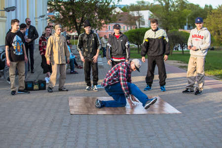 linoleum: Minsk Belarus street dancers performing break dance on a piece of linoleum Editorial