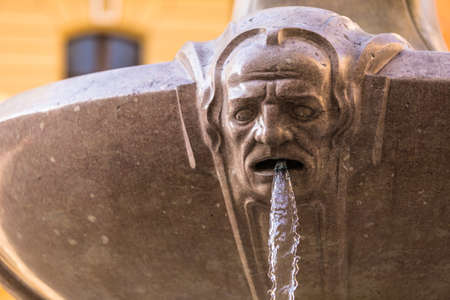 stair well: Fountane part with sculpture and water coming out its mouth Stock Photo