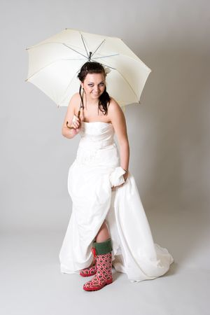 funy bride with umbrella photo