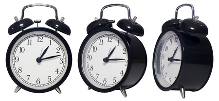 angles: Vintage Alarm black Clock isolated on white in three angles