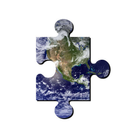 A picture of the earth with jigsaw cut out. Earth picture from NASA. photo