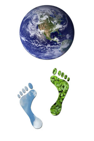 carbon emission: Footprints made up of green leaves and sky leading towards Earth to represent environmental issues or carbon footprint.  Stock Photo