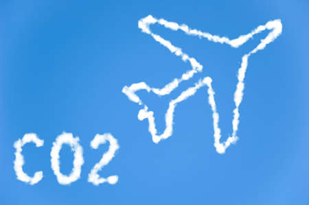 environmental issues: An illustration of an airplane with the text CO2 made up of white puffy clouds to represent environmental issues or carbon footprint.