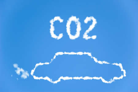 environmental issues: An illustration of a car with the text CO2 made up of white puffy clouds to represent environmental issues or carbon footprint.