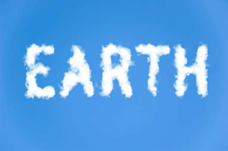 environmental issues: An illustration of the text earth made up of white puffy clouds to represent environmental issues or carbon footprint. Stock Photo