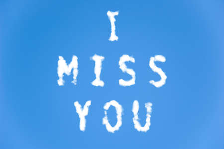 miss you: The letters I miss you written with cloud letters. Stock Photo