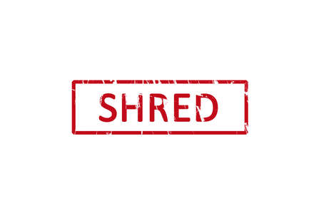 shred: An office rubber stamp with the letters shred