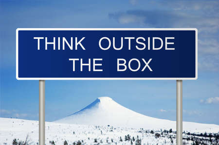 A blue road sign with white text saying think outside the box Stock Photo - 6768191