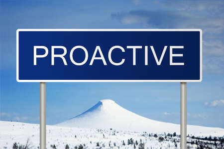 A blue road sign with white text saying Proactive photo