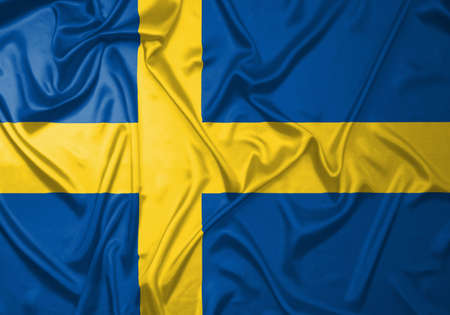 Swedish flag in the shape of wrinkled fabric photo