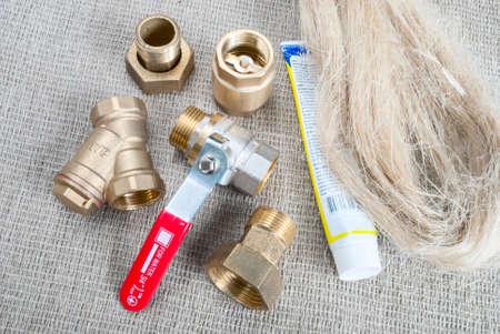 sealing: plumbing fittings, crane, tow and sealing paste Stock Photo