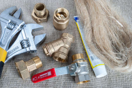 collet: plumbing fittings, crane, tools, tow and sealing paste Stock Photo
