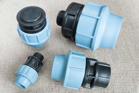 polyethylene: compression couplings and fittings for polyethylene pipes Stock Photo