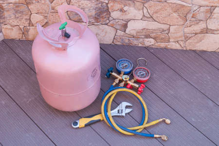 bottle with Freon and tools for refueling of air conditioners