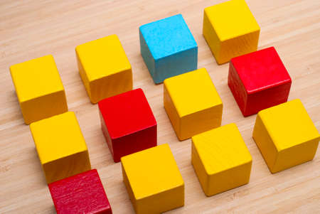 wooden color: cubes of different color lie on a wooden table