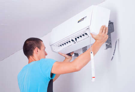 man installs indoor unit of the air conditioner Stock fotó - 42233835