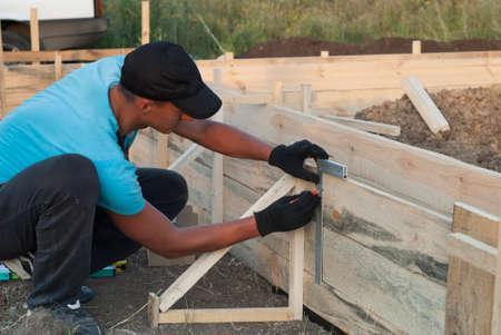 accuracy: A worker checks the accuracy of the formwork
