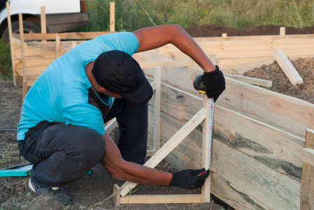 skilled labour: A worker checks the accuracy of the formwork