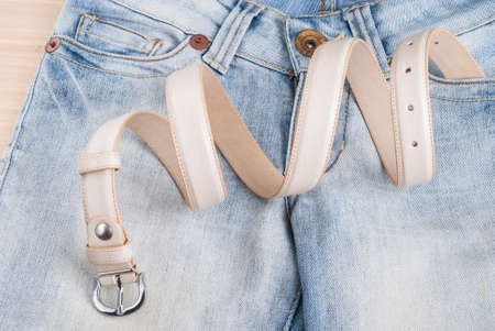 womens jeans on the table and collapsed belt