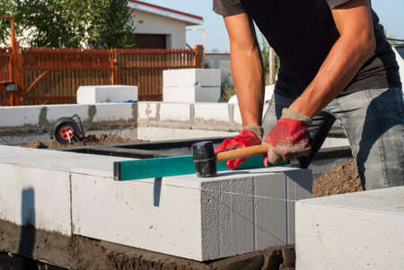 aligning: operating levels in the plane of aerated concrete block Stock Photo