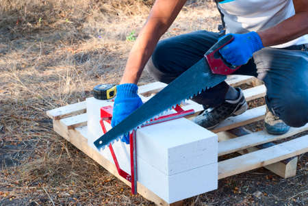 aerated: builder cut into pieces aerated concrete block Stock Photo