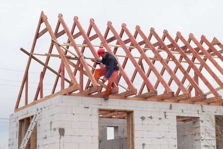 aerated: builder is installing roof system on the house of aerated concrete