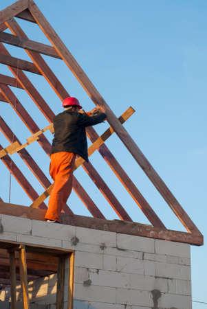 joists: Builder trying to board attic floor joists