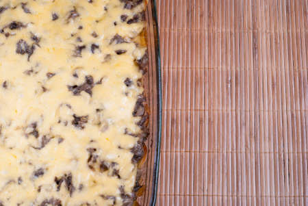 melted cheese: stewed potatoes with mushrooms and melted cheese