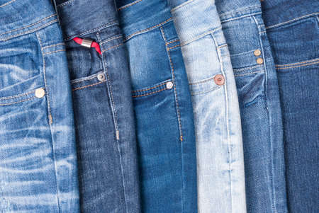 jeans in different colors lying on the table