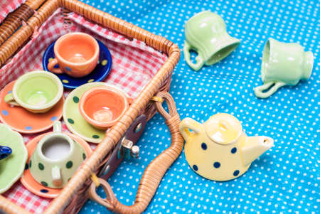 eather: many colored ceramic dishes laid out on a blue background Stock Photo
