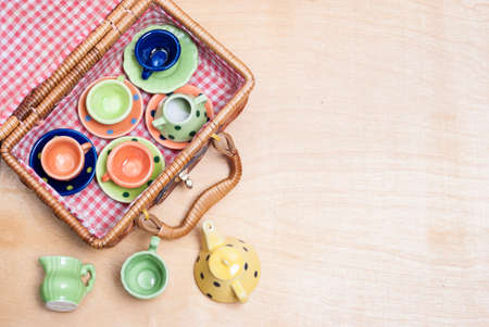 eather: many colored ceramic dishes laid out on a table Stock Photo