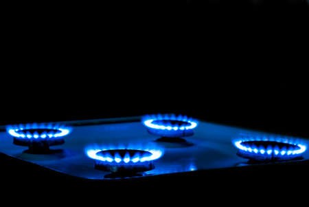 gas stove: blue flame gas stove in the dark Stock Photo