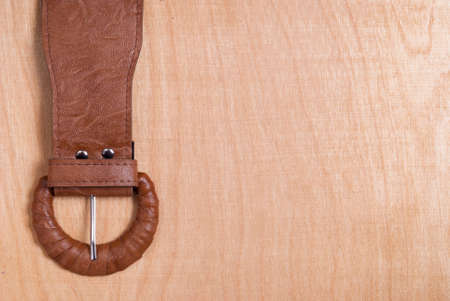 buckle: belt buckle on the background of wood texture