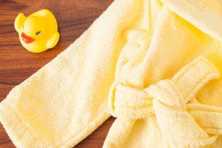 rubber ducky: rubber ducky and a childrens bathrobe on the table
