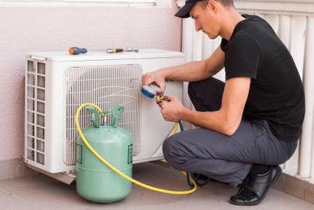 master: master of repair air conditioners at work