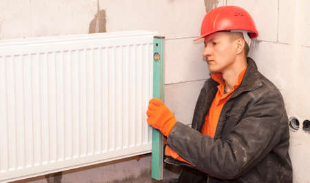 bubble level: plumber check bubble level horizontal installation radiator