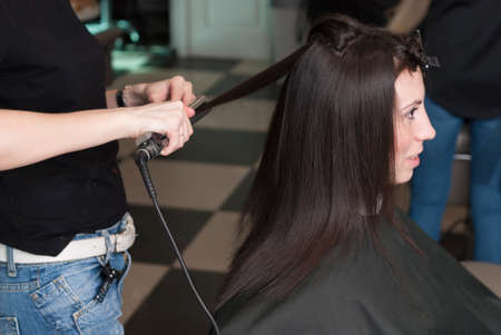 scissors: hairdresser in the beauty salon makes the girl a new haircut